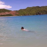 Berenang di pantai Mawun
